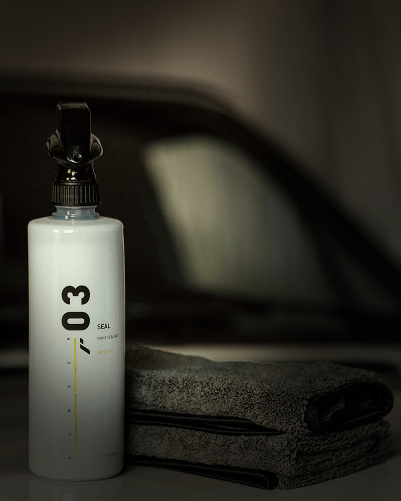 RestorFX Number 03 Seal product bottle and 16 Numbers Microfiber with a car in the background